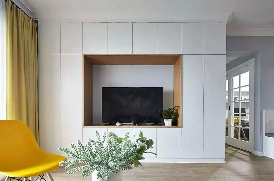 北欧风客厅电视柜设计,一般是独立凸出的,但是这个电视柜是内嵌在墙壁